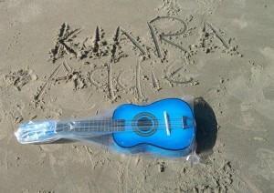 Guitar & names in sand