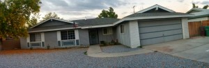 This was before any of the upgrades - old windows, old garage door, old paneling, and tons of rock...